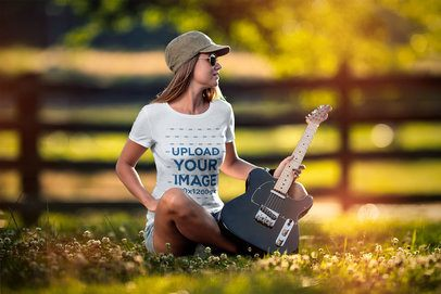 T-Shirt Mockup Featuring a Woman Holding an Electric Guitar 4986-el1