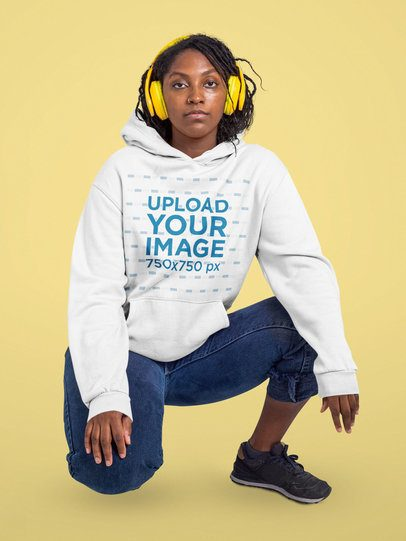 Hoodie Mockup of a Woman with Headphones Posing Against a Customizable Background 42991