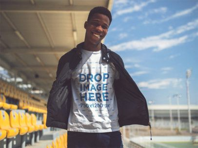 Jovial Young Man Wearing Round Neck Tee and Jacket While Hanging Out at a Stadium Template a14251