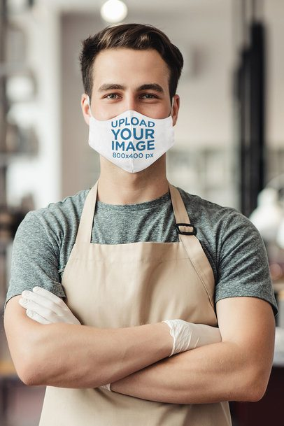 Face Mask Mockup Featuring a Worker With His Arms Crossed 42130-r-el2