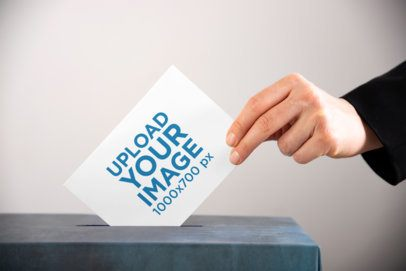 Mockup of a Horizontal Flyer Being Placed Inside a Ballot Box 42255-r-el2