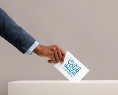 Mockup of a Man Placing a Folded Flyer Inside a Ballot Box 42249-r-el2