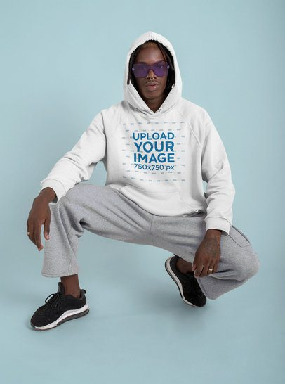 Pullover Hoodie Mockup of a Man With Purple Sunglasses Posing at a Studio 42988