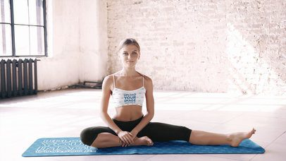 Sports Bra Mockup Featuring a Young Woman Sitting on a Yoga Mat 37835-r-el2