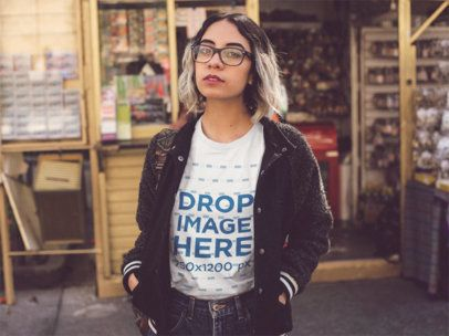 Edgy Hispanic Girl with Sunglasses Wearing a Round Neck Tee While Near a Shop Template a13561