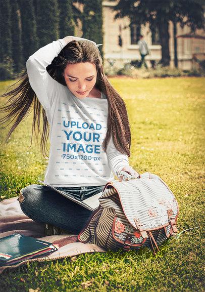 Sweatshirt Mockup of a Student Sitting on the Grass 35445-r-el2