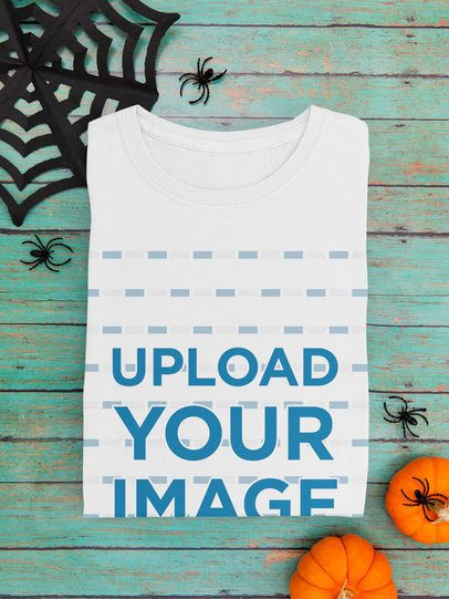 Mockup of a Folded T-Shirt Featuring Halloween Decorations m101
