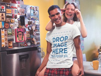 Young Couple Having Fun While at Their Kitchen Wearing T-Shirts Mockupa13485