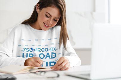 Mockup of a Woman Wearing a Sweatshirt while Working 41826-r-el2