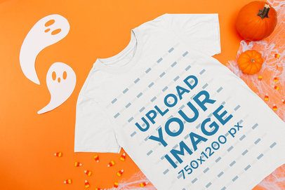 Mockup of a Flat Laid T-Shirt on a Surface with Halloween Items m109