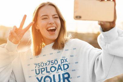 Crewneck Sweatshirt Mockup of a Happy Woman Taking a Selfie at Sunset 42719-r-el2
