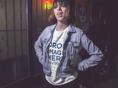 Hispanic Girl With Short Hair Wearing a T-Shirt and a Denim Jacket While Doing Faces in the City at Night Mockup a13565