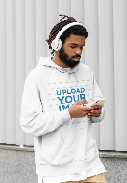 Mockup of a Serious Bearded Man Wearing a Pullover Hoodie on the Street 42625-r-el2