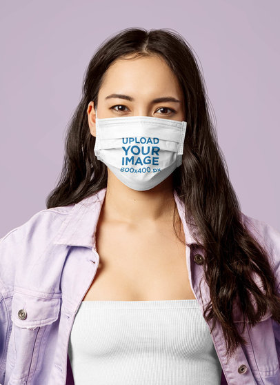 Mockup Featuring a Serious Long-Haired Woman Wearing a Customizable Face Mask at a Studio 42861-r-el2