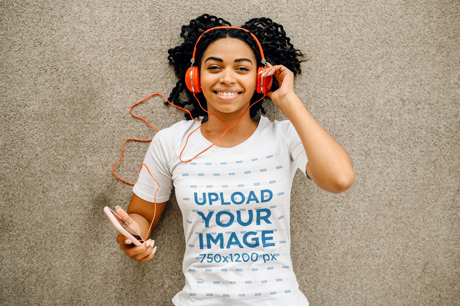 Mockup of a Woman with a T-Shirt Lying on the Floor and Listening to Music 39254-r-el2