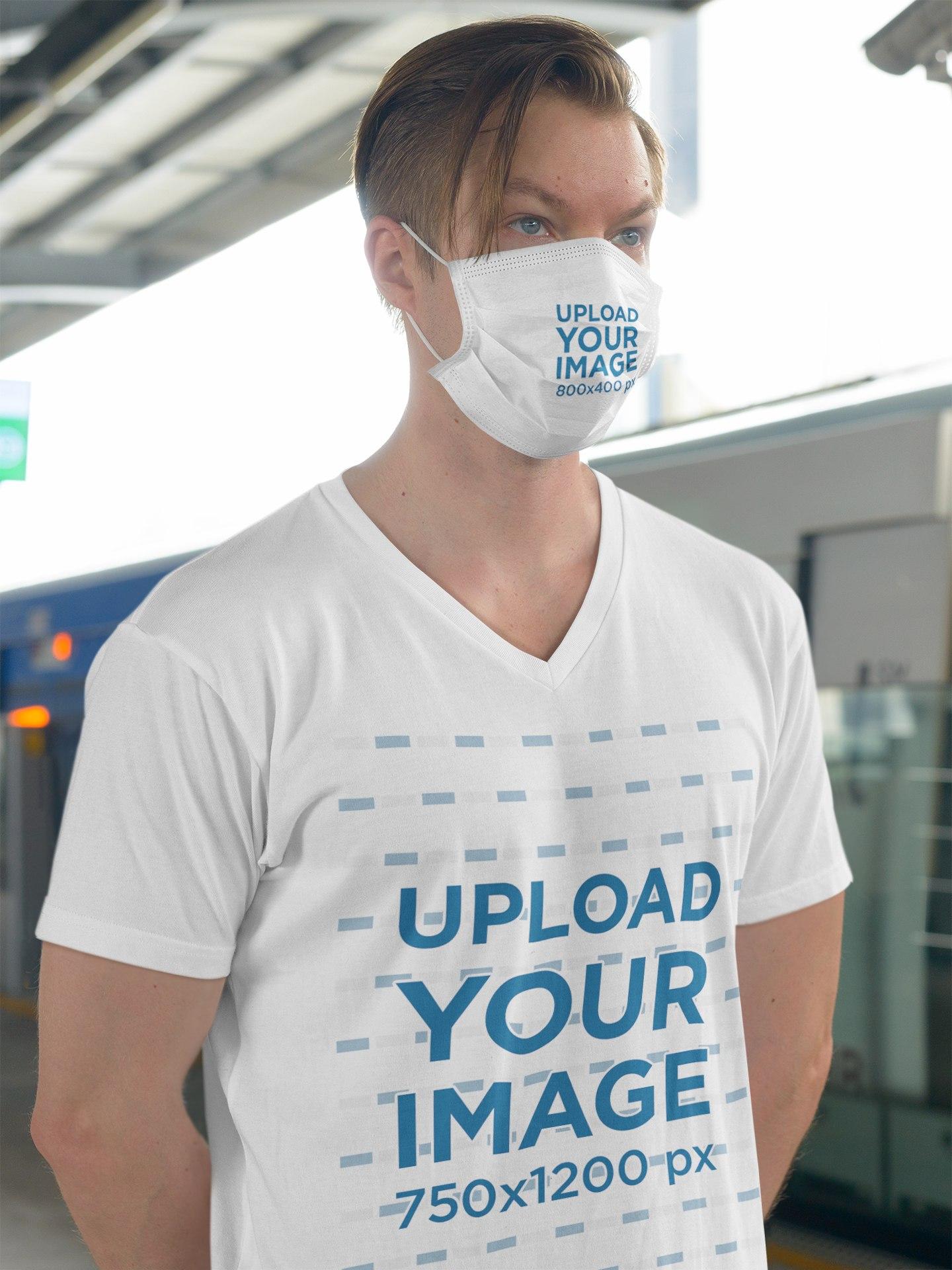 T-Shirt Mockup of a Man Wearing a Face Mask at the Train Station 44032-r-el2