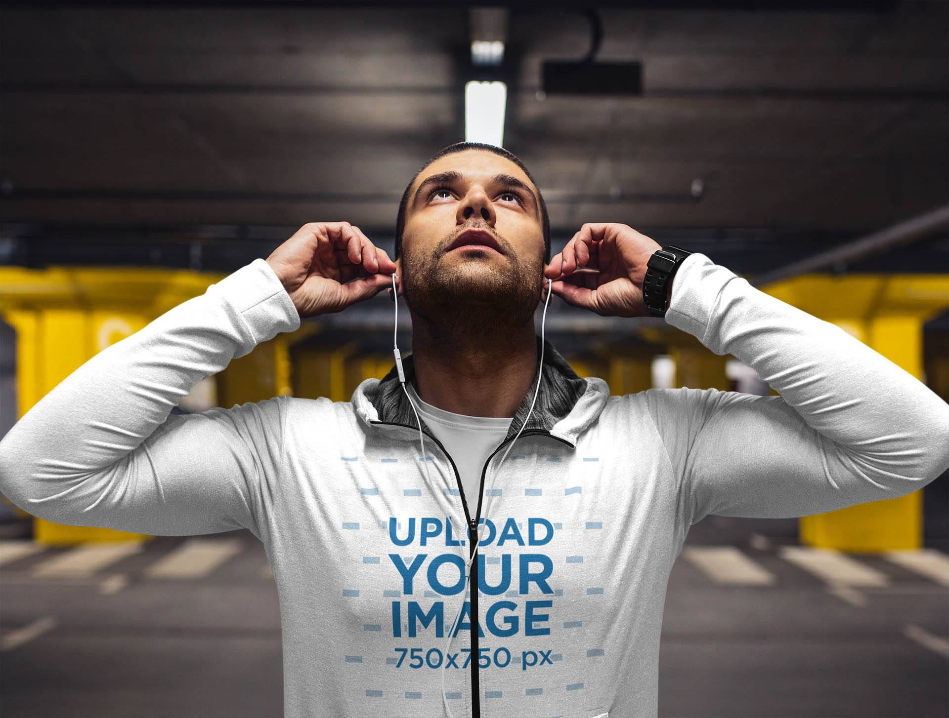 Hoodie Mockup of a Man Putting on His Earphones While to Exercise 41428-r-el2