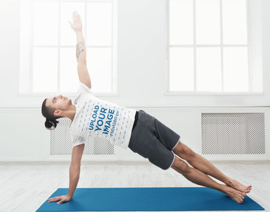 T-Shirt Mockup of a Man Doing a Yoga Pose in Home 43209-r-el2