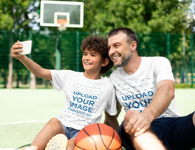 T-Shirt Mockup Featuring a Kid and His Father Taking a Selfie at a Basketball Court 43678-r-el2