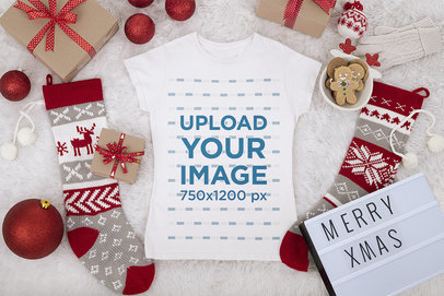 Mockup of a Women's Tee Flat Laid on a Christmas-Decorated Surface m41