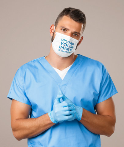 Face Mask Mockup Featuring a Young Male Nurse at a Studio 43979-r-el2