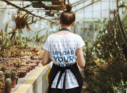 Back-View T-Shirt Mockup of a Woman at a Plant Nursery 44077-r-el2