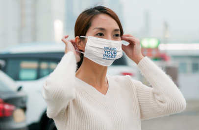 Mockup Featuring a Woman Putting Her Face Mask On 44539-r-el2