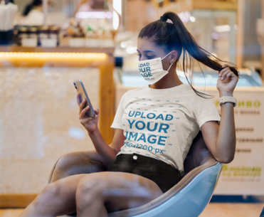 T-Shirt Mockup of a Young Woman Wearing a Face Mask and Checking Her Phone 41377-r-el2