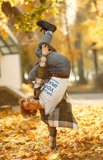 T-Shirt Mockup of a Man Breakdancing on Dry Leaves 41364-r-el2
