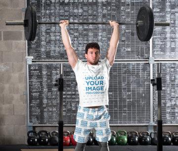 T-Shirt and Shorts Mockup of a Man Lifting a Barbell Over His Head 43769-r-el2
