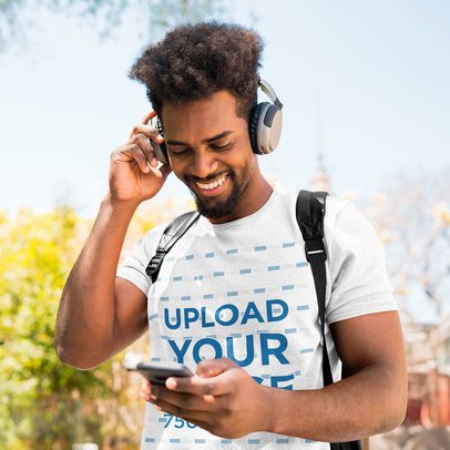 Heather T-Shirt Mockup of a Happy Man Listening to Music on the Street 41821-r-el2