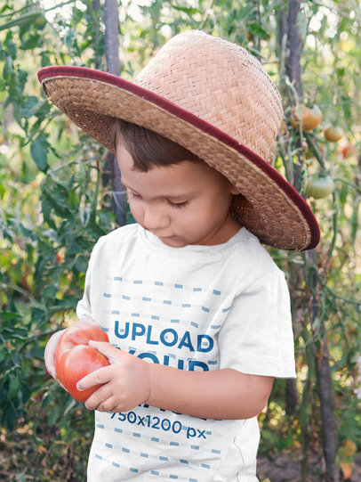 T-Shirt Mockup Featuring a Boy Holding a Tomato 44363-r-el2