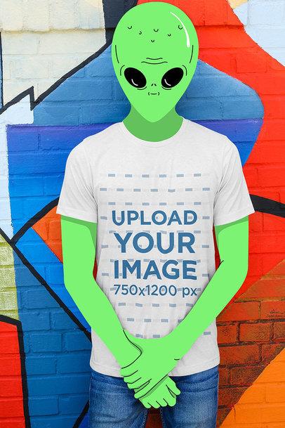 Illustrated Mockup of a Green Alien Wearing a T-Shirt in an Urban Scenario 3179-el1