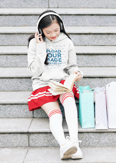 Mockup of a Teen Girl Wearing a Heathered Hoodie While Studying 44478-r-el2