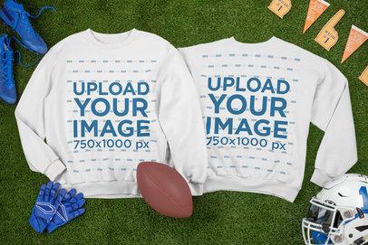 Mockup of Two Crewneck Sweatshirts Laid Next to Football Equipment m327