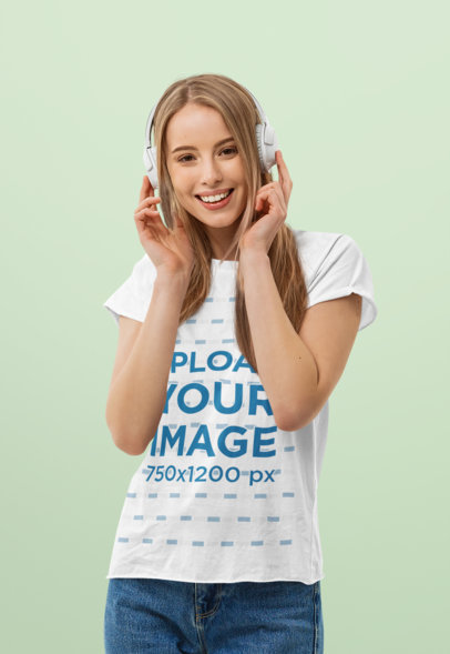 Mockup of a Woman with a T-Shirt and Headphones Standing in a Studio 44429-r-el2