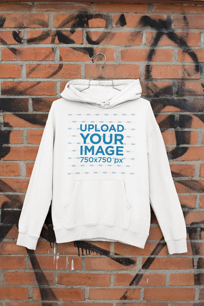 Mockup of a Hanging Hoodie by a Brick Wall m461
