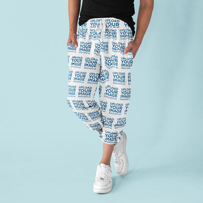 Sweatpants Mockup Featuring a Man Posing in a Studio 15608a