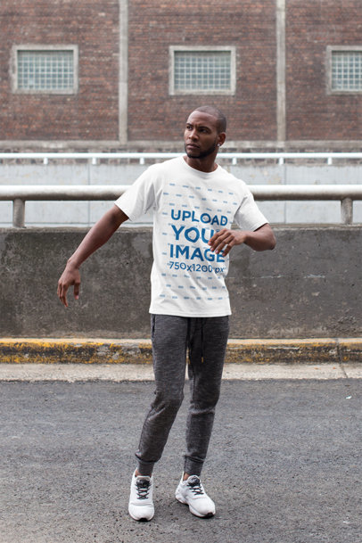 T-Shirt Mockup of a Man Wearing an Athleisure Look While Crossing the Street 16902a