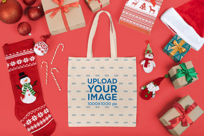 Mockup of a Flat Laid Tote Bag Surrounded by Christmas Decorations m18