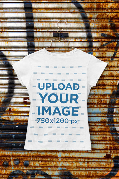Mockup of a Hanging Women's T-Shirt Featuring a Rusty Background M455