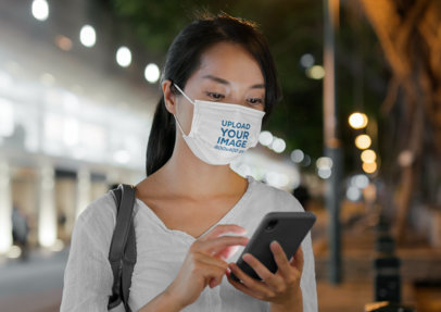 Sublimated Face Mask Mockup Featuring a Serious Woman Checking Her Phone 44819-r-el2