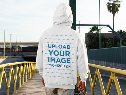 Back-View Hoodie Mockup of a Man Standing on a City Street m523