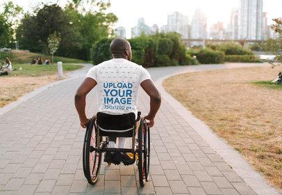 Back-View T-Shirt Mockup Featuring a Man Using a Wheelchair 45092-r-el2