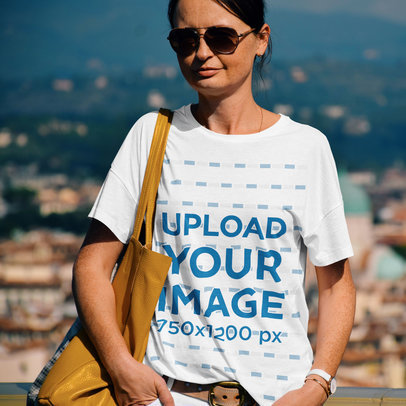 Mockup of a Woman Wearing a Loose T-Shirt While Traveling 45044-r-el2