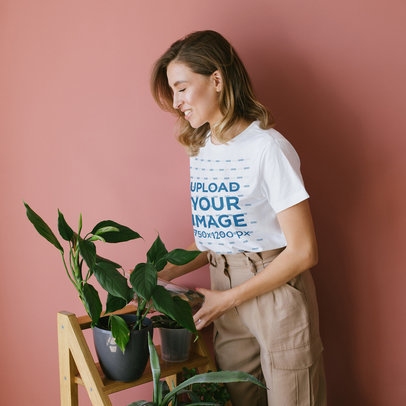 T-Shirt Mockup of a Woman Watering Her Plants 45031-r-el2
