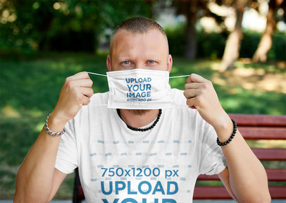 T-Shirt Mockup of a Man Holding a Face Mask in Front of His Face 45009-r-el2
