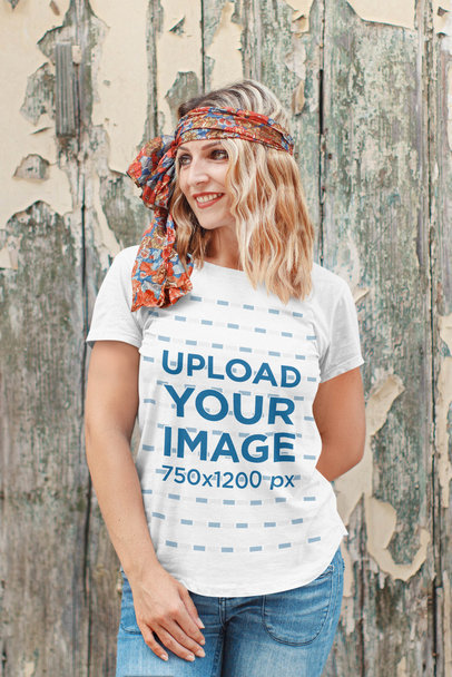 T-Shirt Mockup Featuring a Smiling Woman Posing by an Old Wooden Wall 44746-r-el2