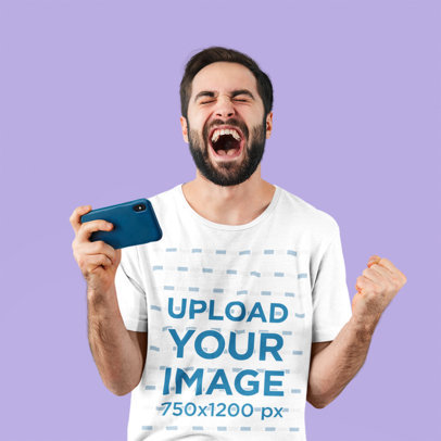 T-Shirt Mockup Featuring an Excited Man Holding a Phone 45148-r-el2