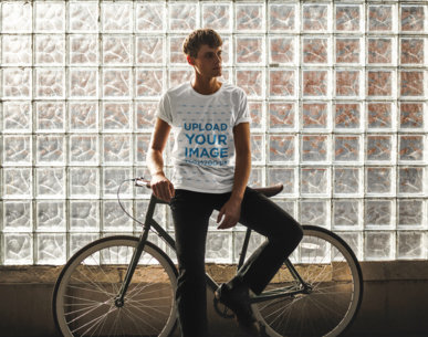 Mockup of a Man with a Round Tee Leaning on His Bike 43188-r-el2